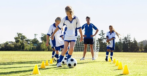 Children with hearing impairment play football