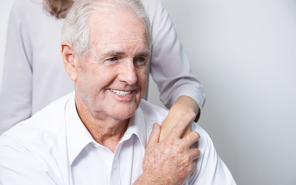 grandfather with hearing aid