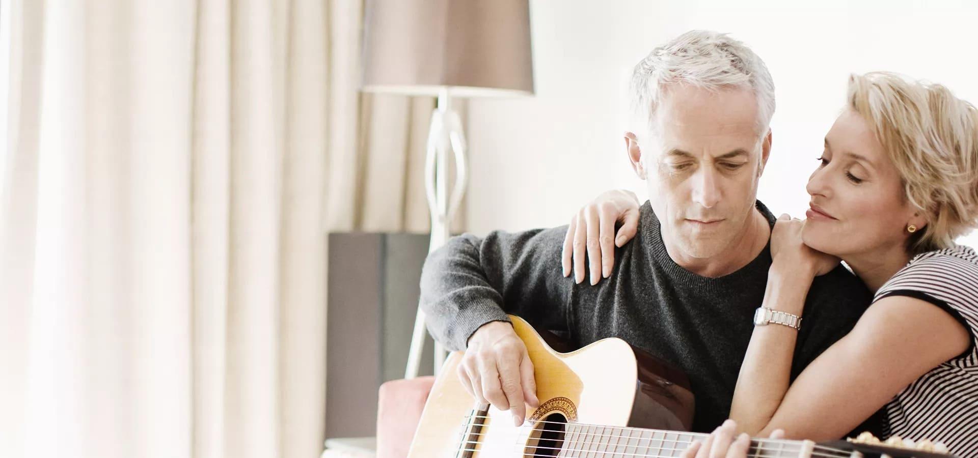 deaf man playing guitar